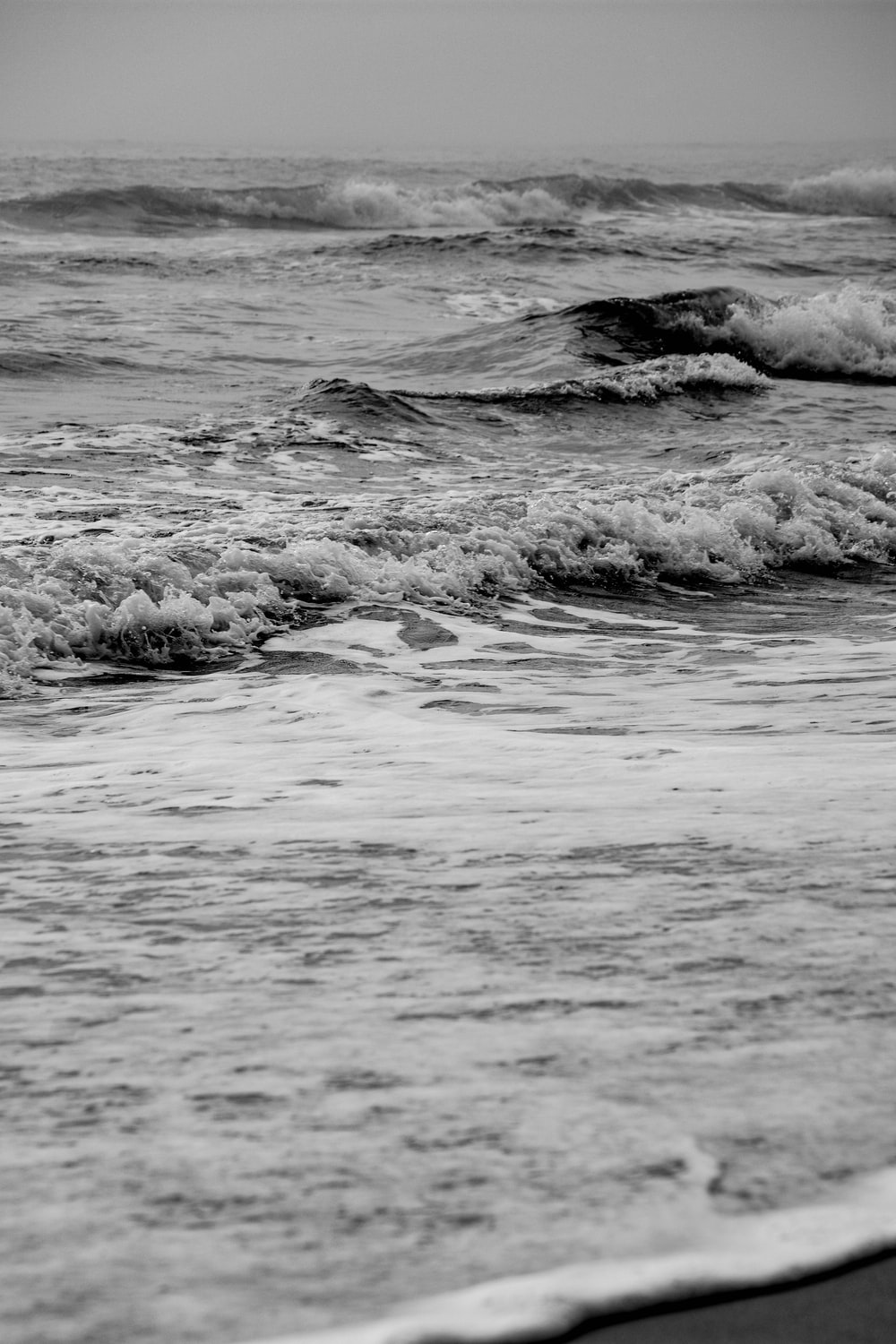 grayscale photo of ocean waves