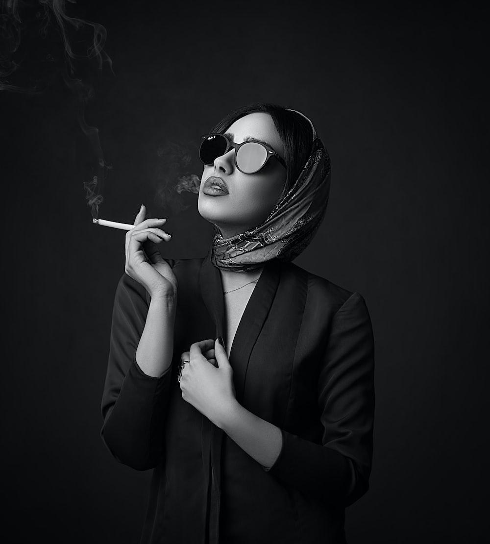 woman in black blazer wearing sunglasses