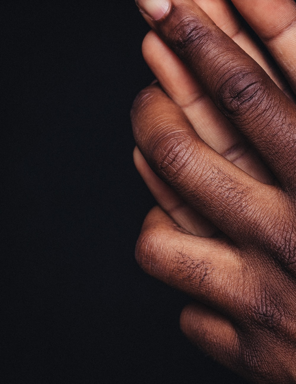 persons hand on black background