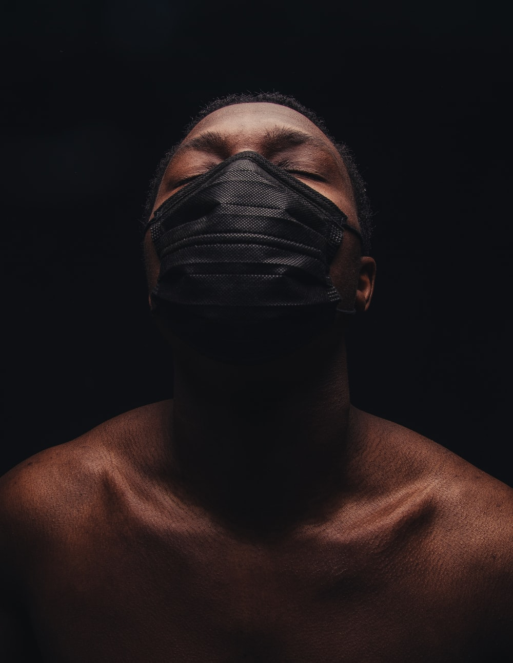 topless woman with black face mask