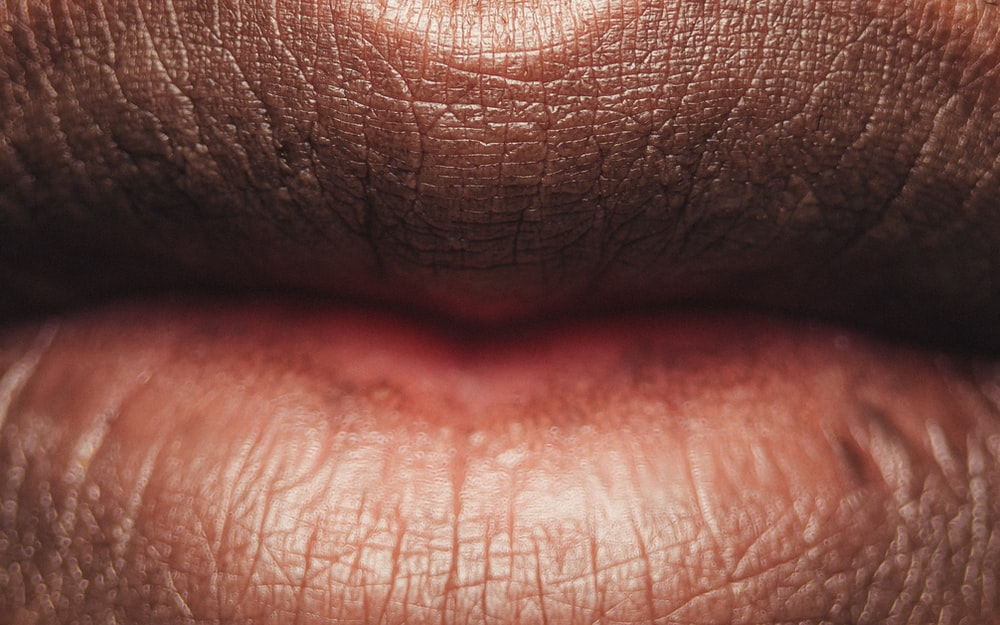 persons lips with red lipstick