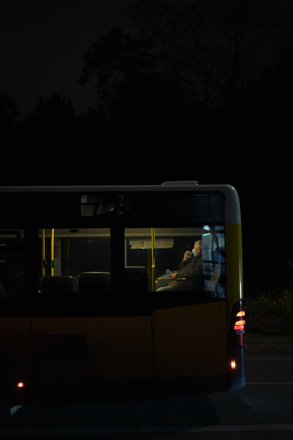 white and blue bus on road during night time