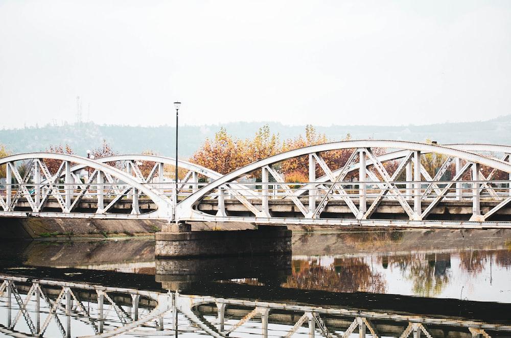white and brown bridge over river