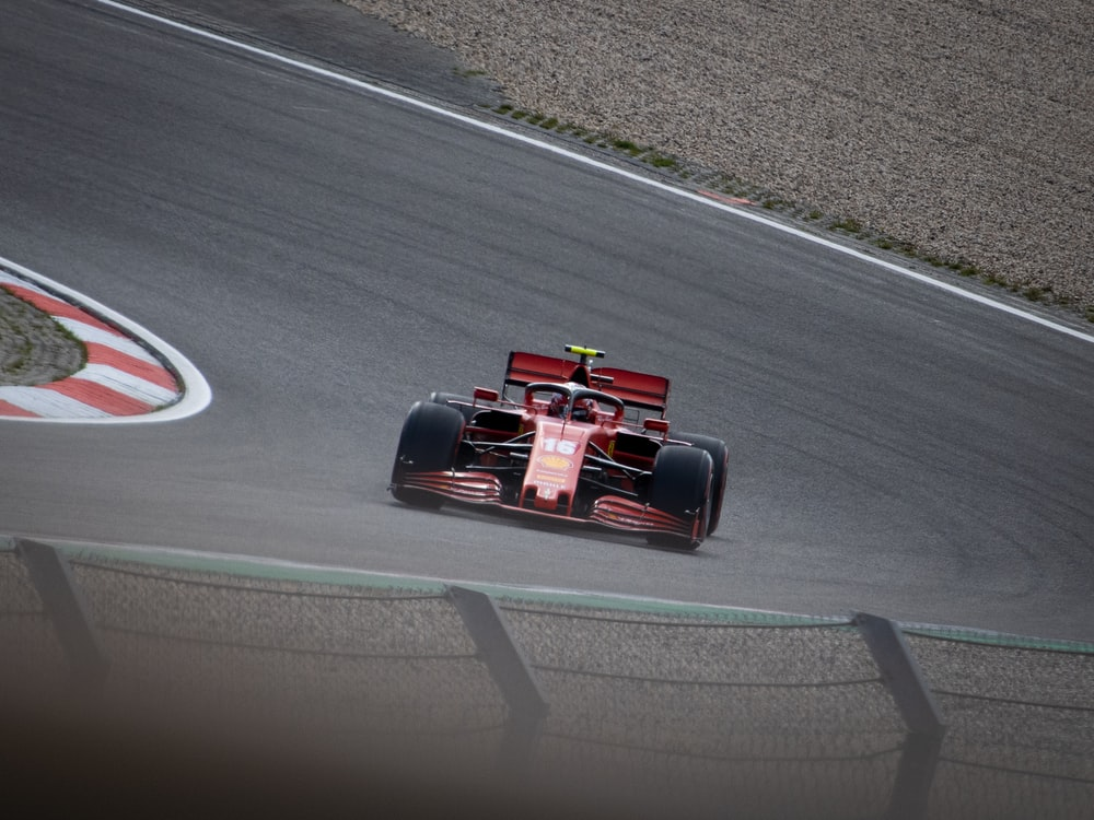 red and black formula 1 on road