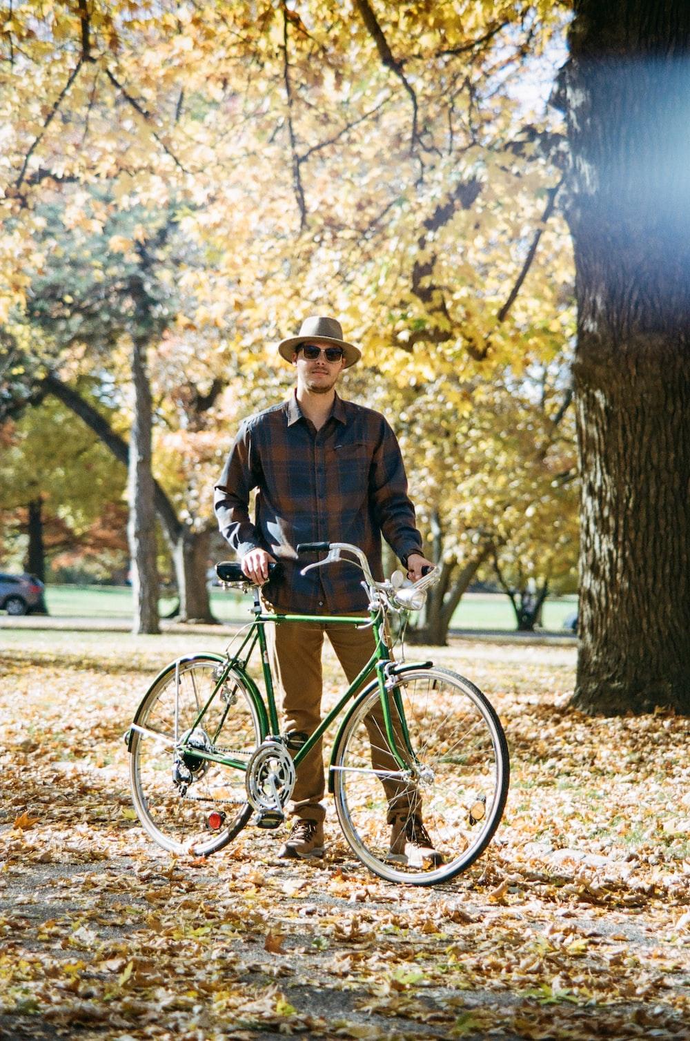 man in black jacket riding on bicycle