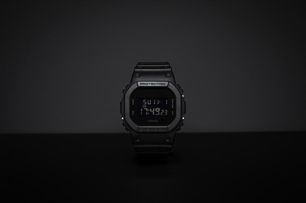 black casio digital watch at 11 00