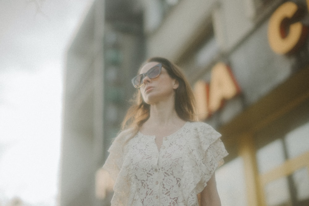 woman in white floral dress wearing sunglasses