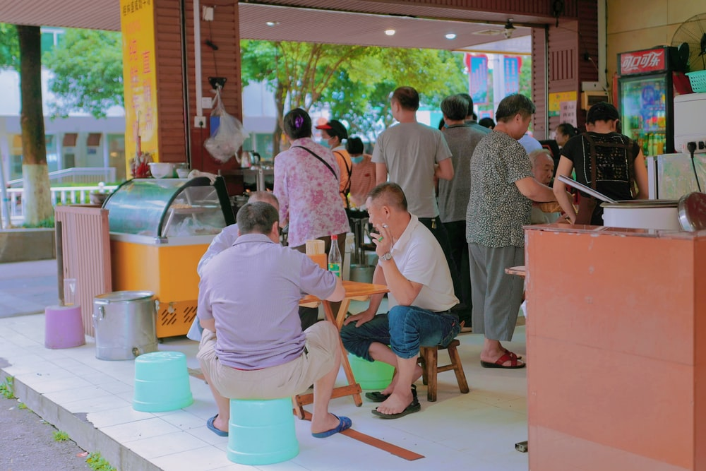 people sitting on orange and blue chairs