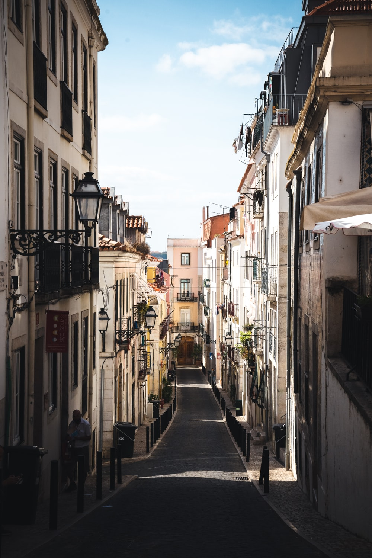 people walking on street between buildings during daytime