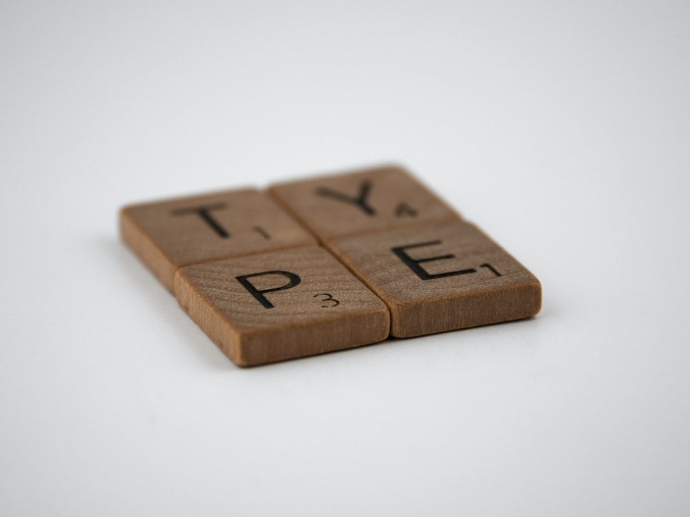 brown wooden blocks with number 6
