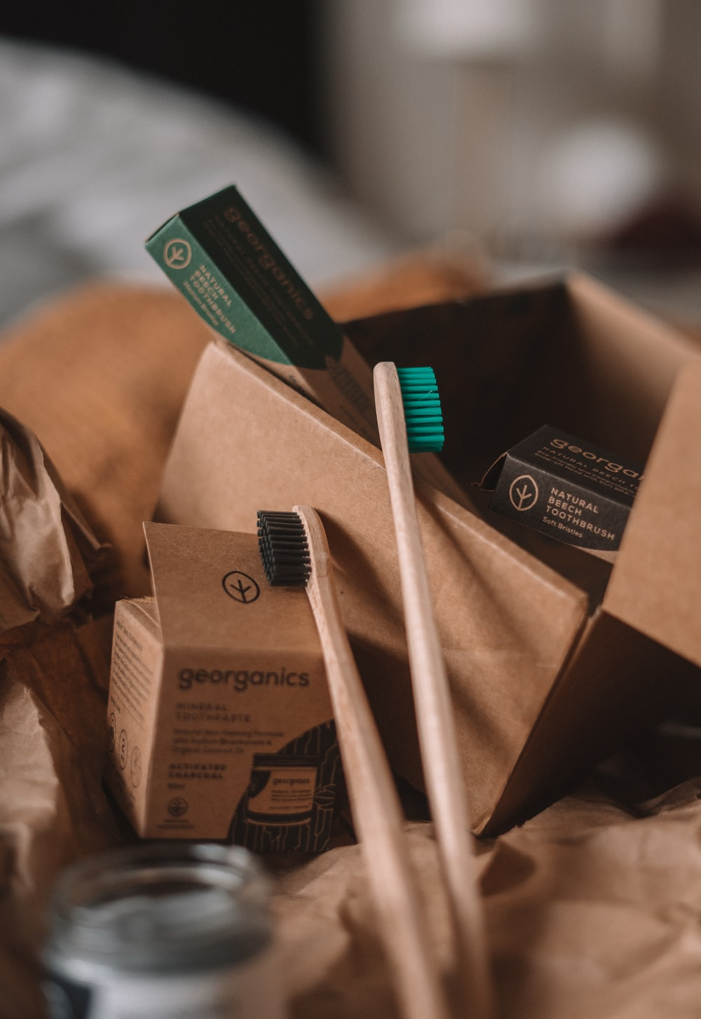 green and white toothbrush on brown carton box