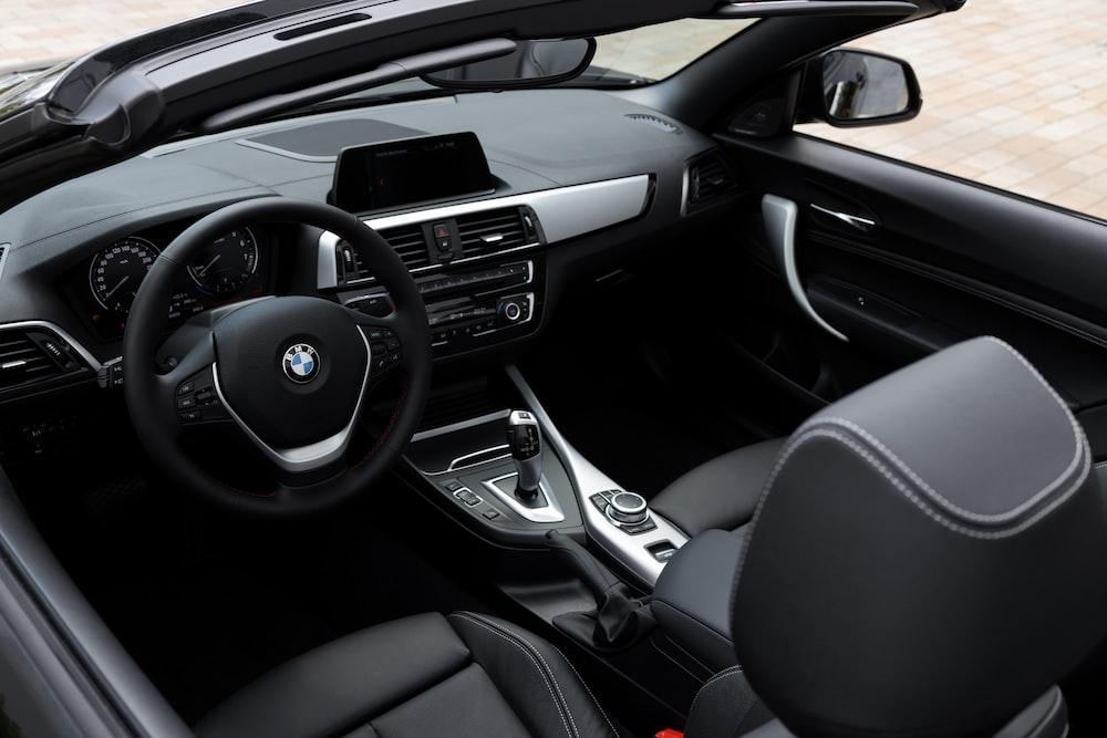 black and silver bmw car steering wheel