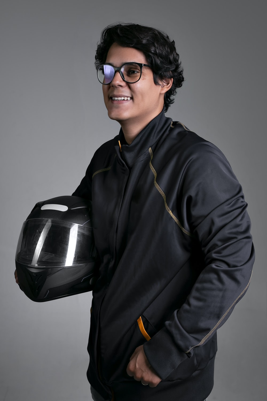 man in black jacket wearing black sunglasses