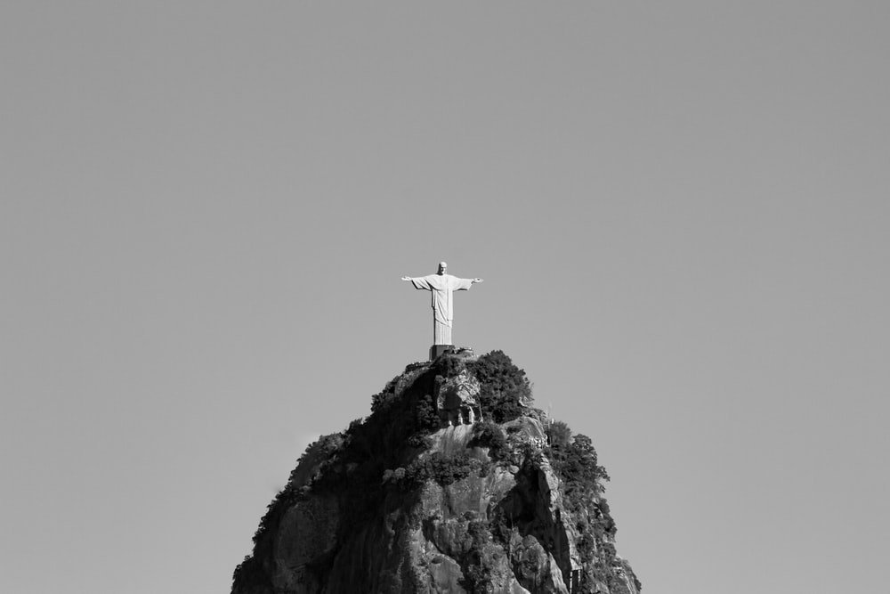 white cross on top of rock