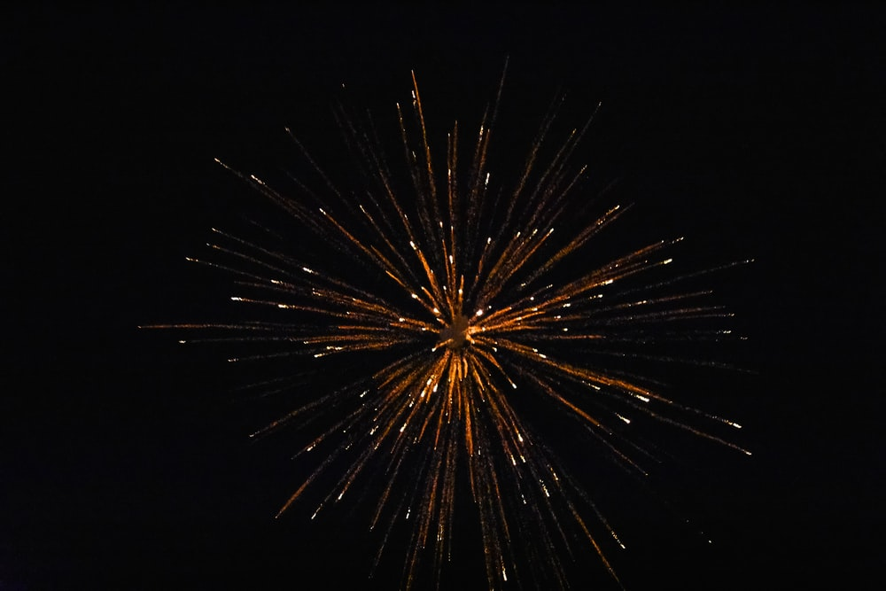 red fireworks in the sky during night time