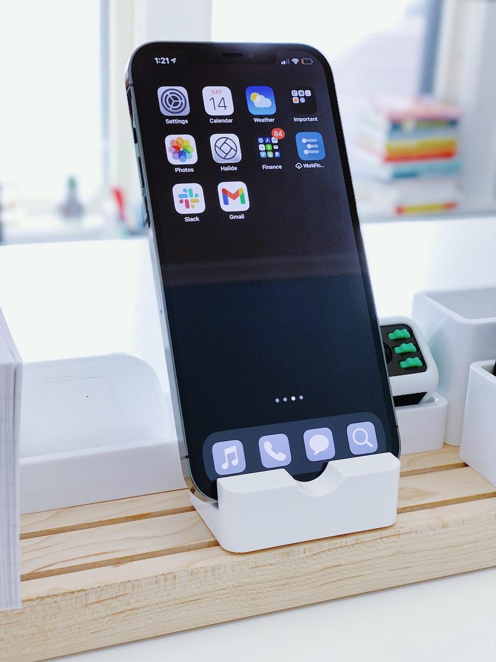 black iphone 4 on white box