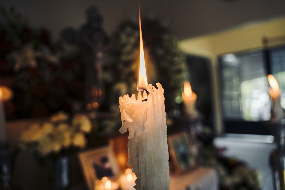 white candle in a room