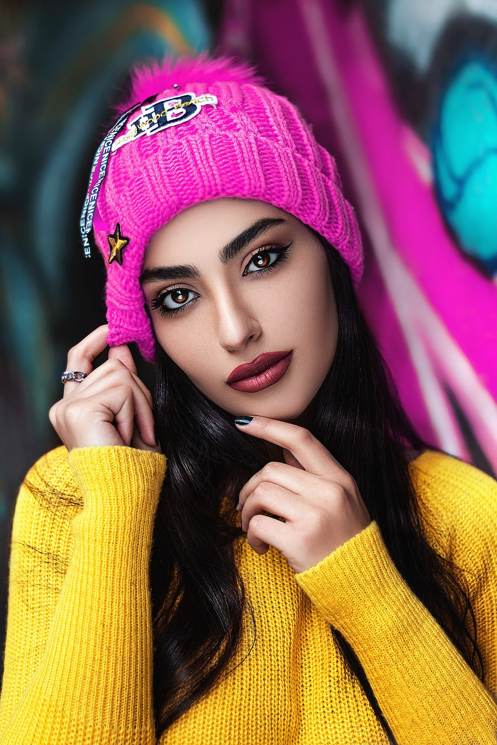 woman in yellow knit sweater and knit cap