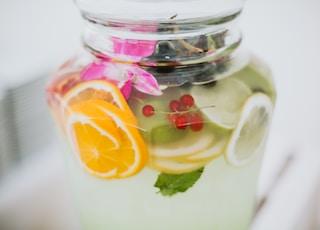 clear glass jar with yellow lemon