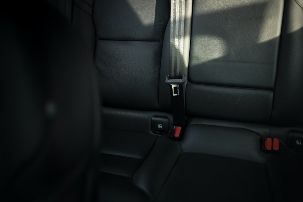 black leather car seat with seat belt