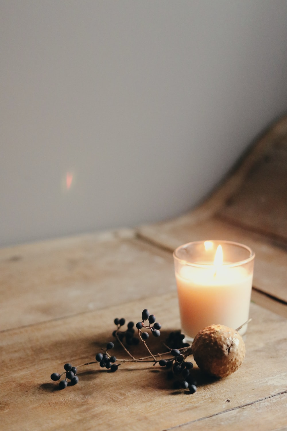 white candle on brown wooden table