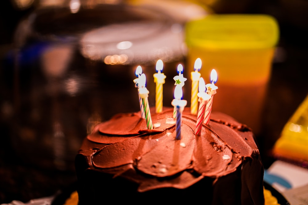brown cake with candles on top