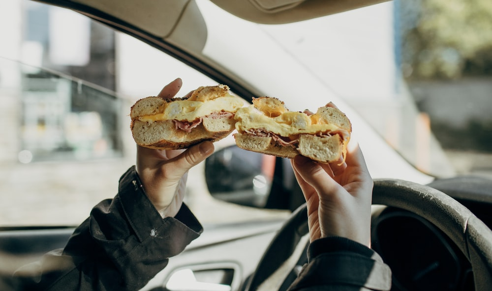 person holding bread with meat