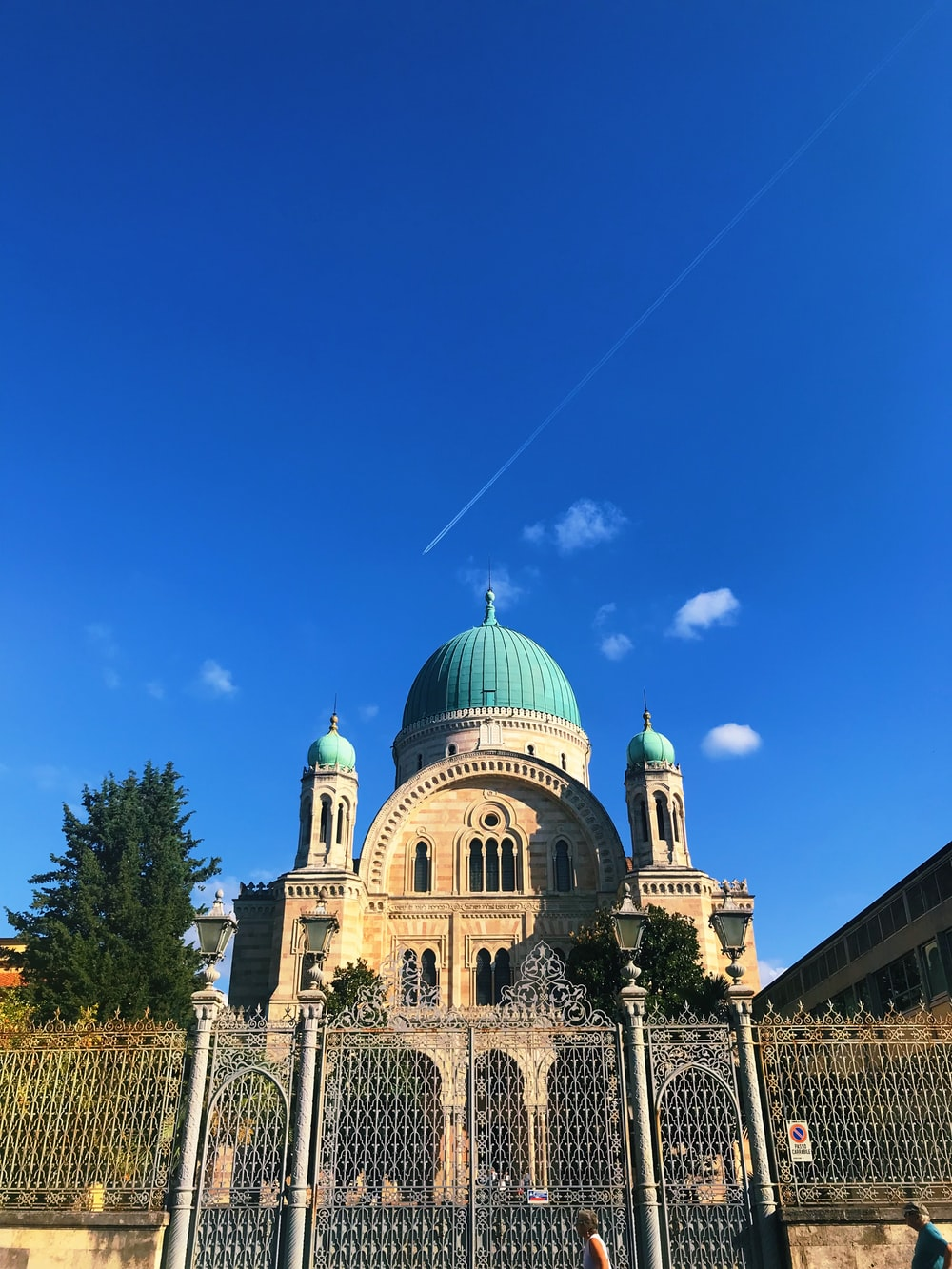 white and green dome building under blue sky during daytime
