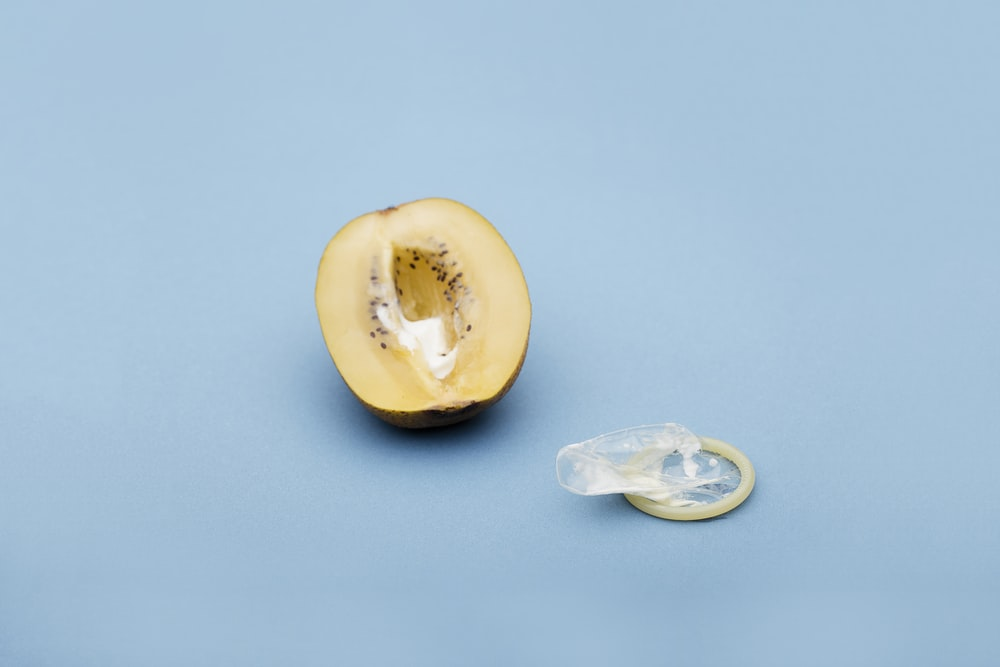 sliced yellow fruit on white surface