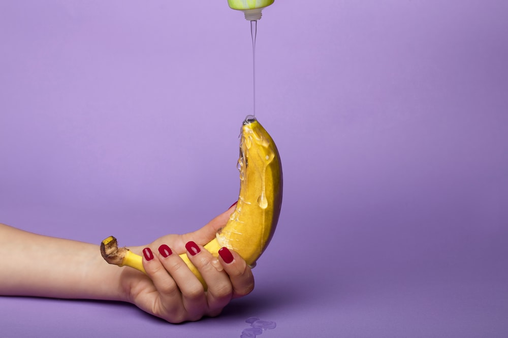 yellow banana fruit on persons hand
