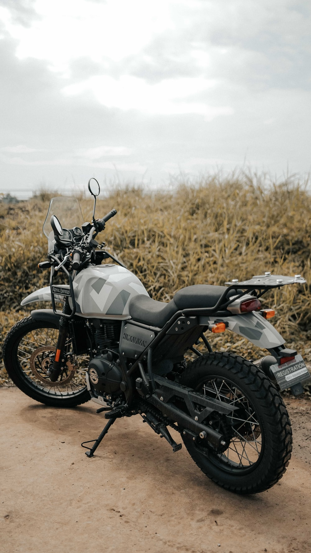 black and gray motorcycle on brown grass field during daytime