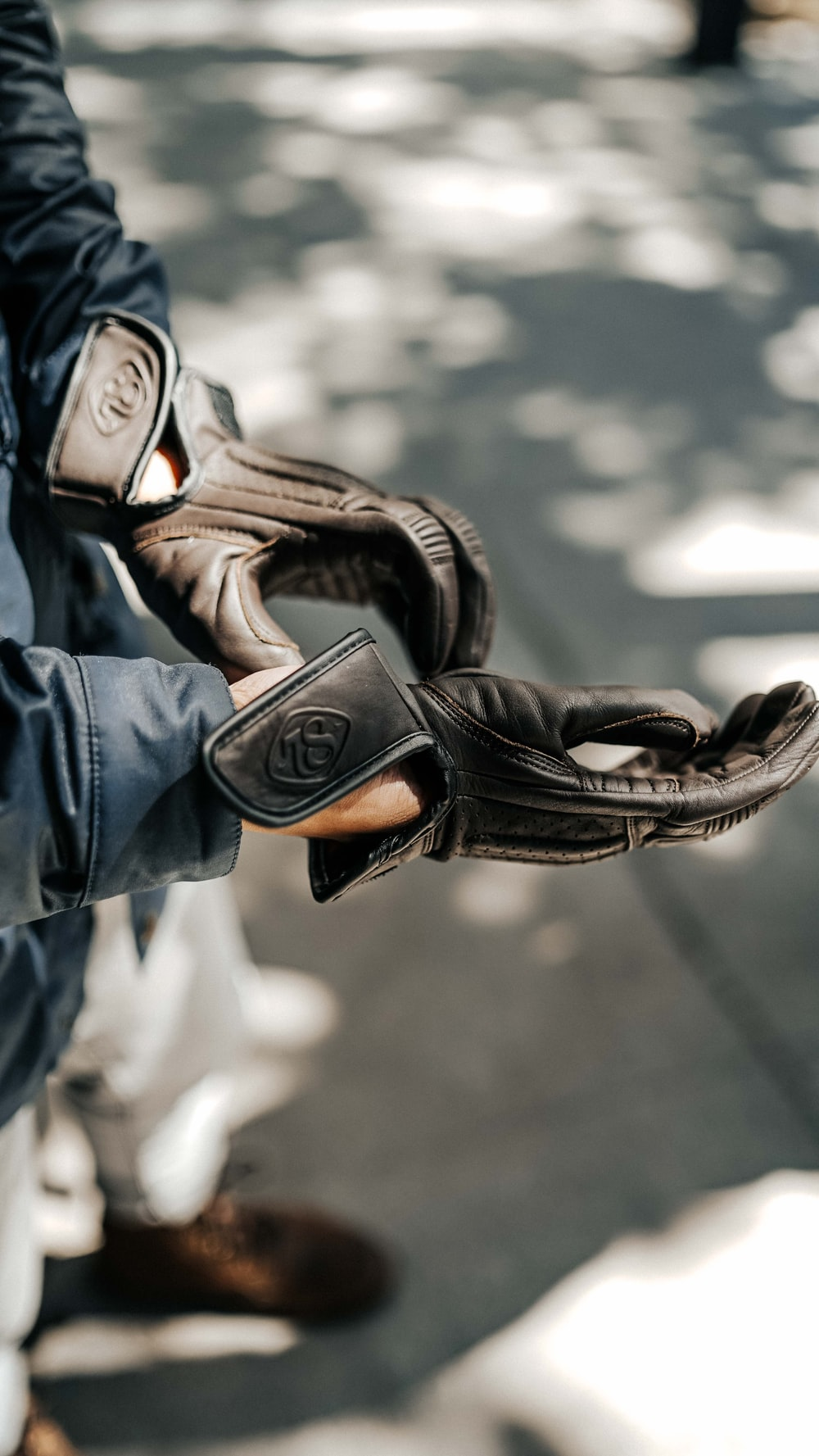 person in black leather boots