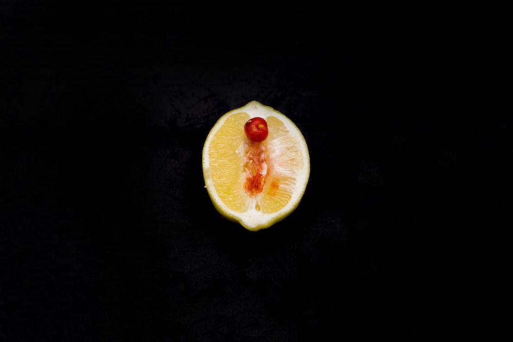 sliced fruit on black surface