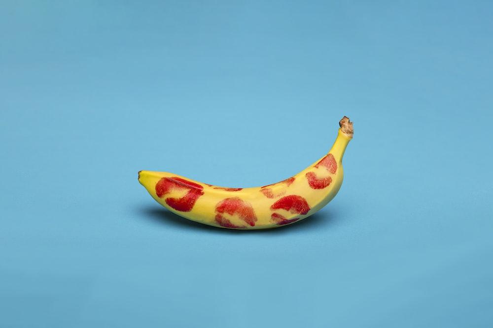 yellow banana fruit on blue surface