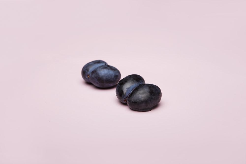 black round fruits on white surface