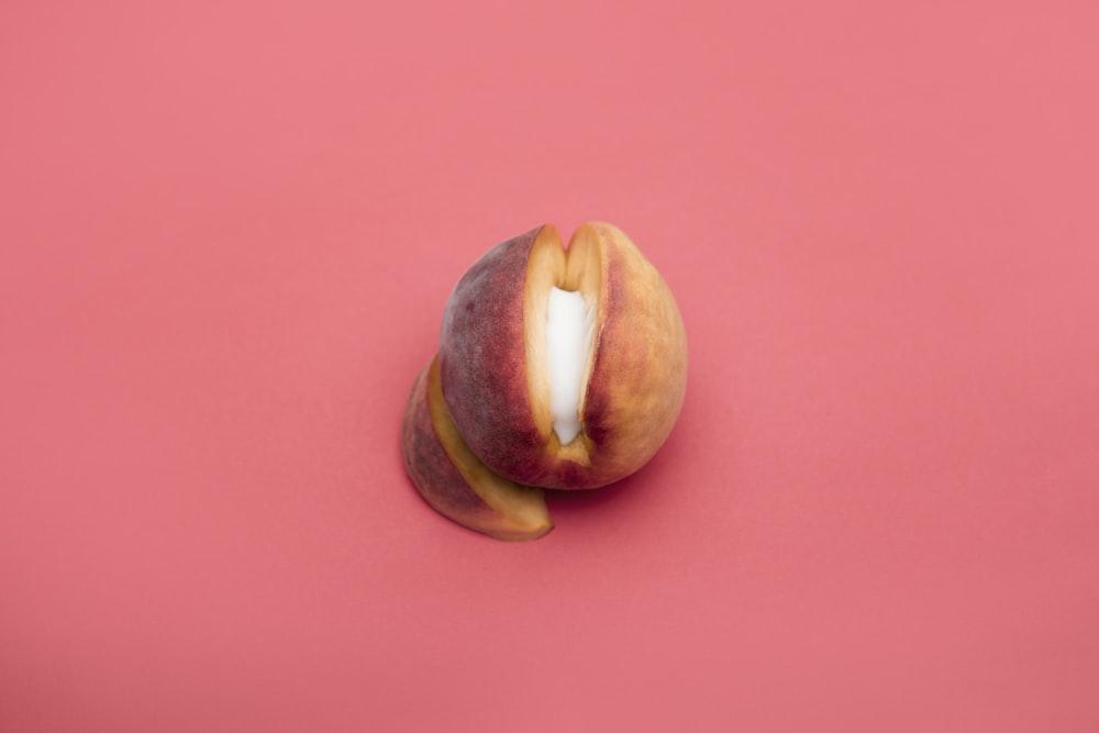 sliced apple fruit on red surface