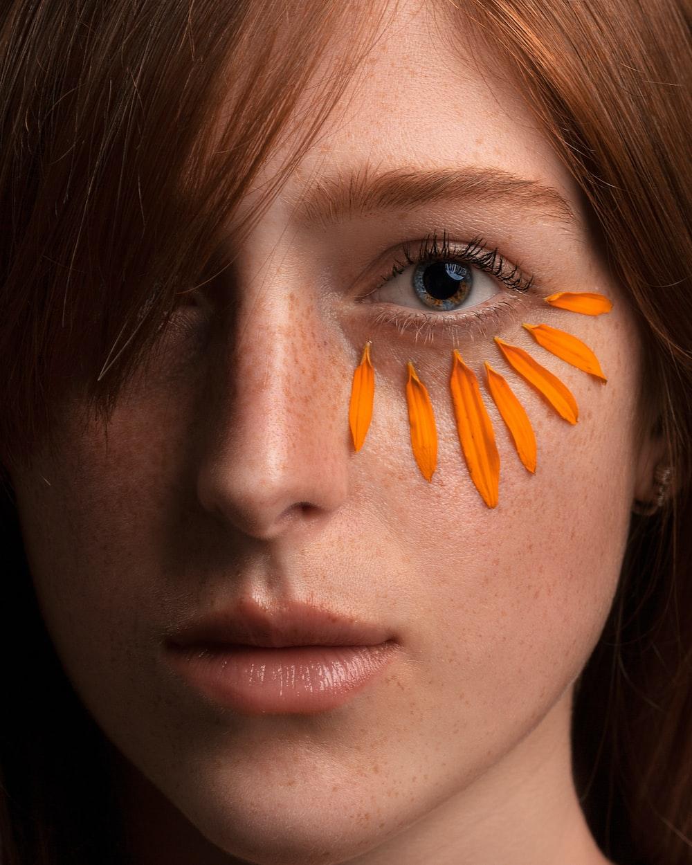 woman with orange hair clip