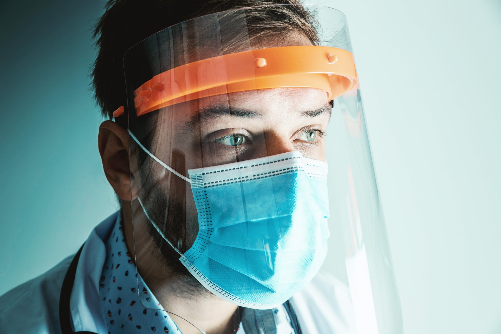Male Doctor wearing face shield for Coronavirus outbreak or Covid-19. Concept of Covid-19 quarantine.