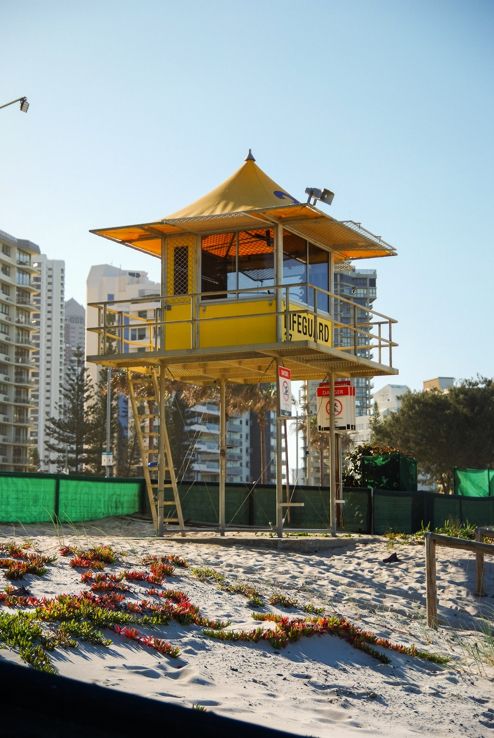 white and brown wooden lifeguard tower