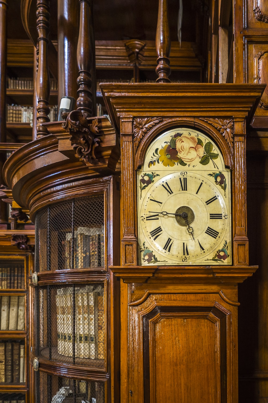 brown wooden framed analog clock at 10 30