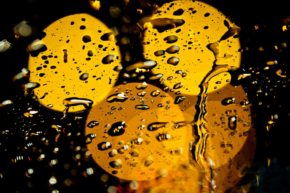 water droplets on yellow surface