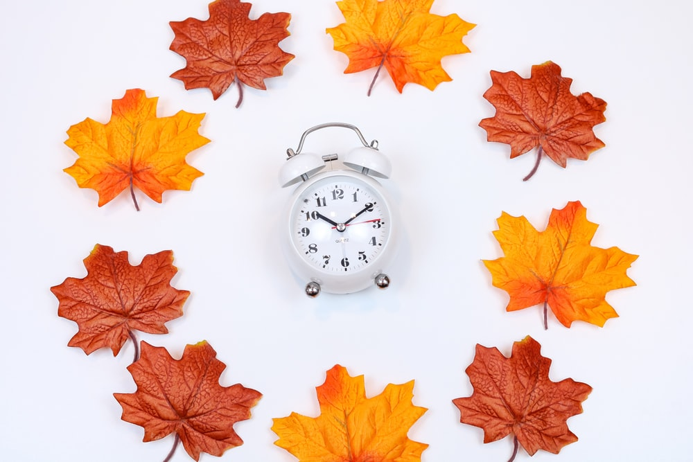 silver and white analog alarm clock