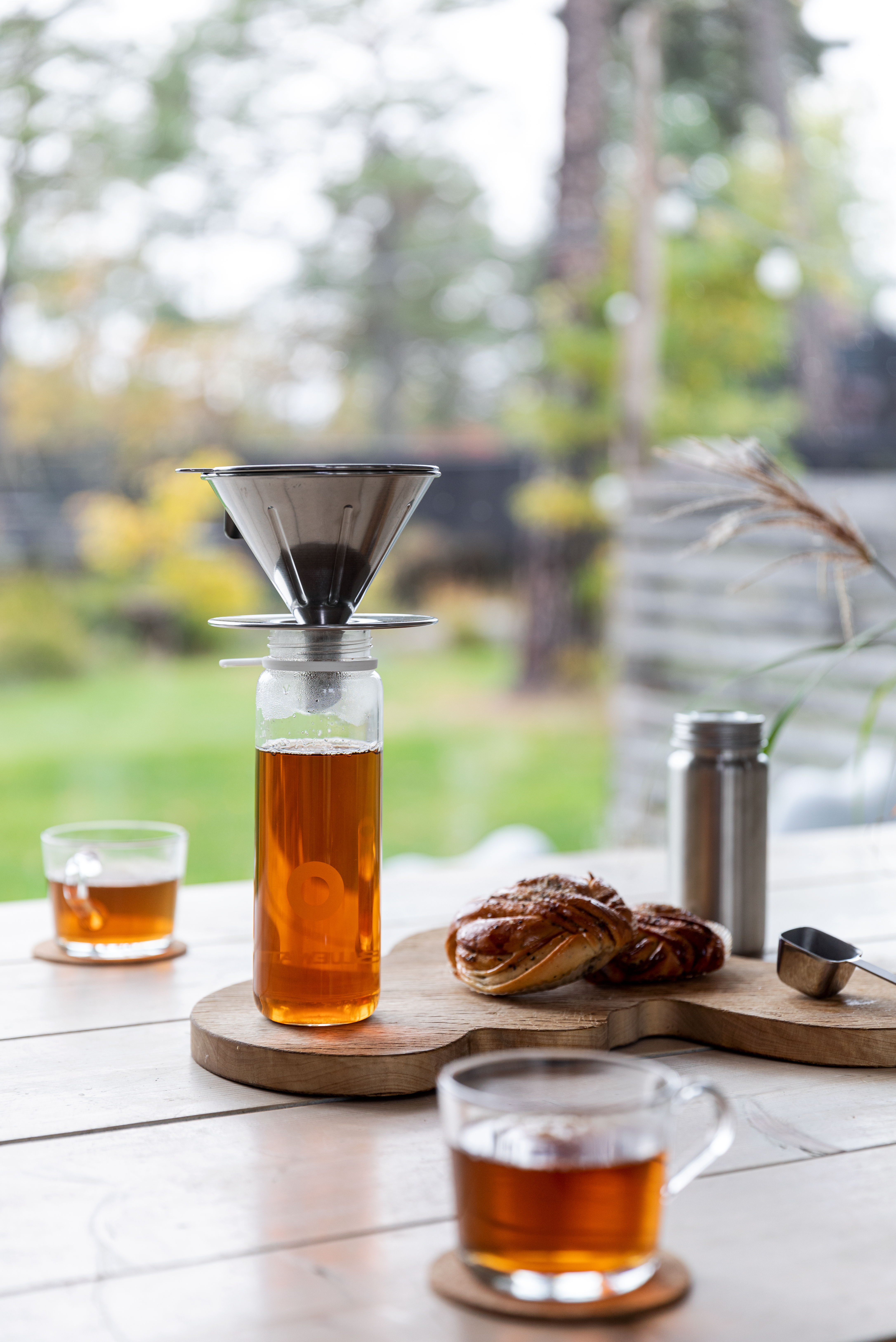 clear-glass-cup-with-yellow-liquid-on-brown-wooden-chopping-board