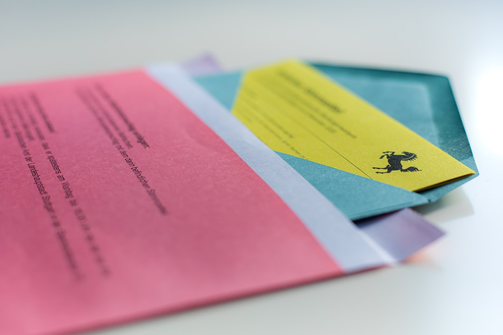 pink blue and yellow papers