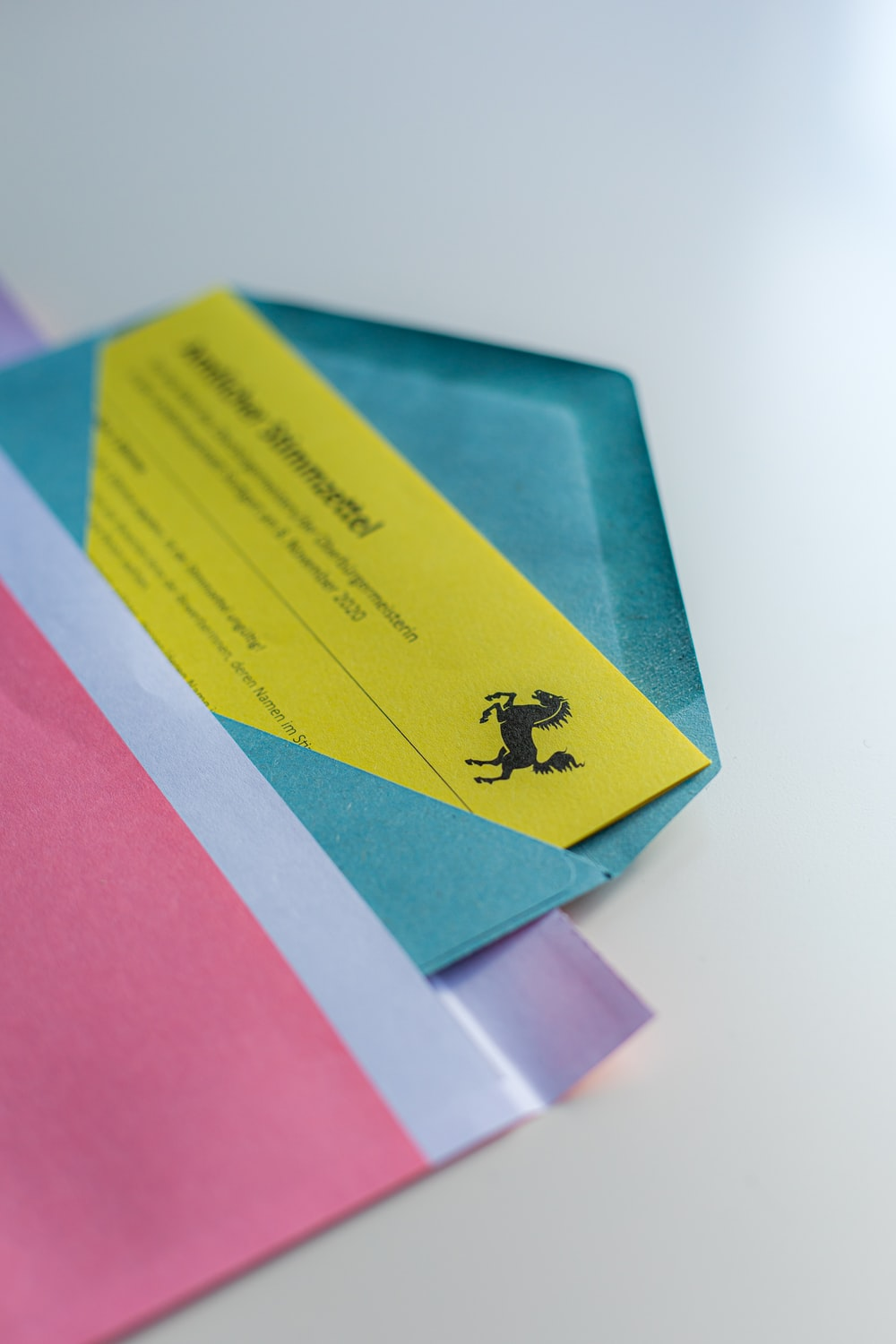 blue and yellow card on pink paper