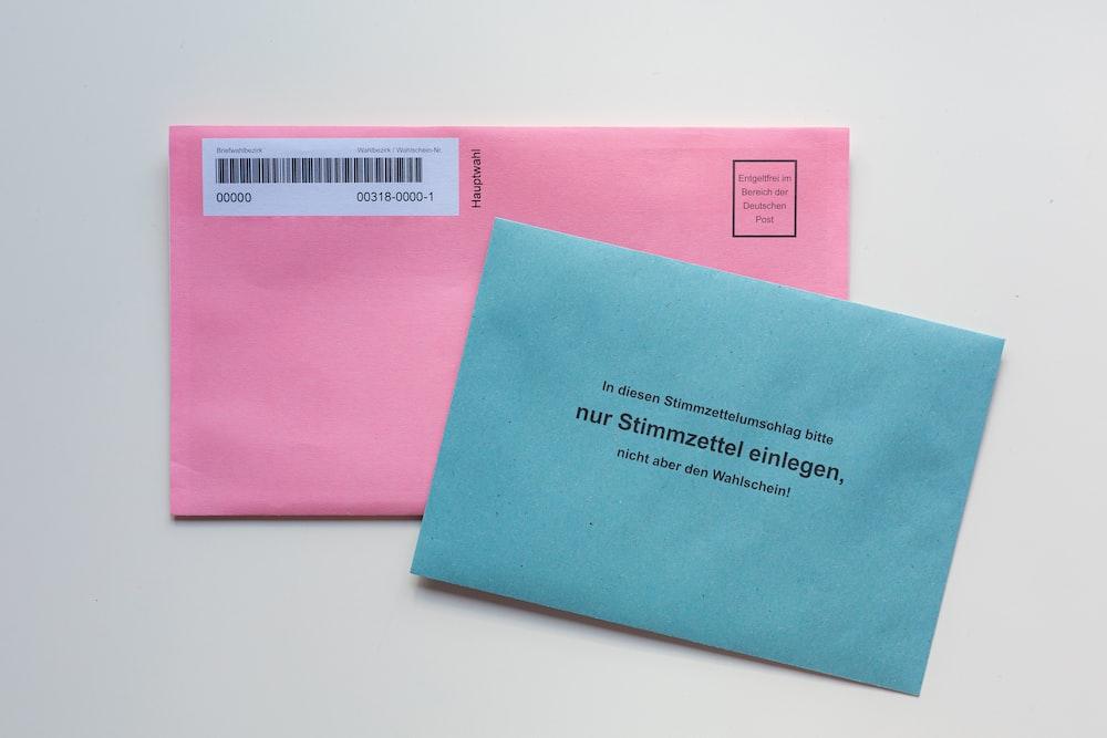 blue envelope on white table