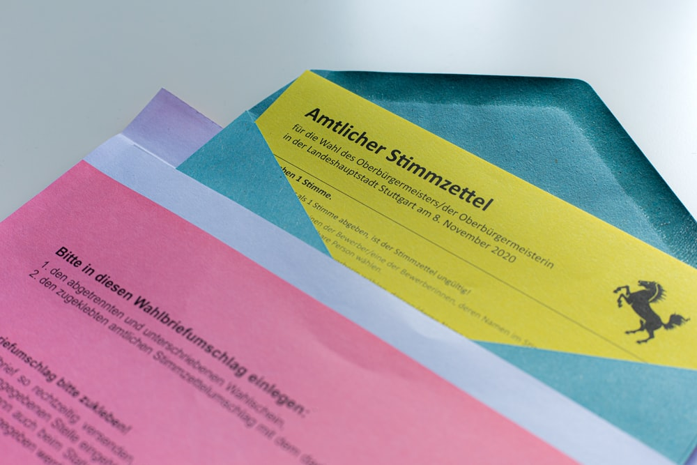 pink and yellow paper on blue textile