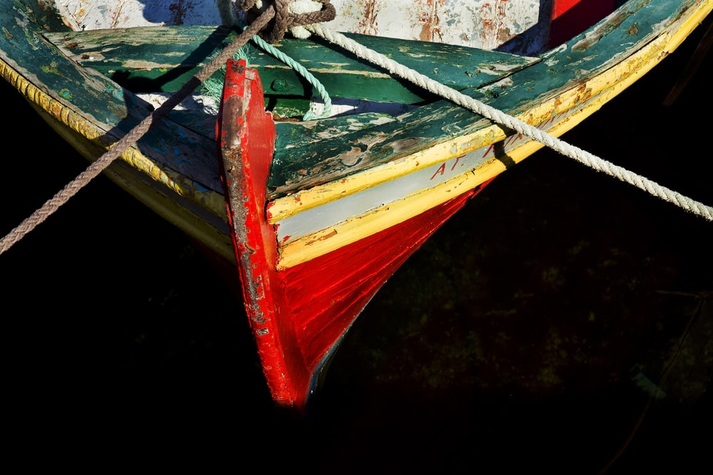 red and blue boat on water