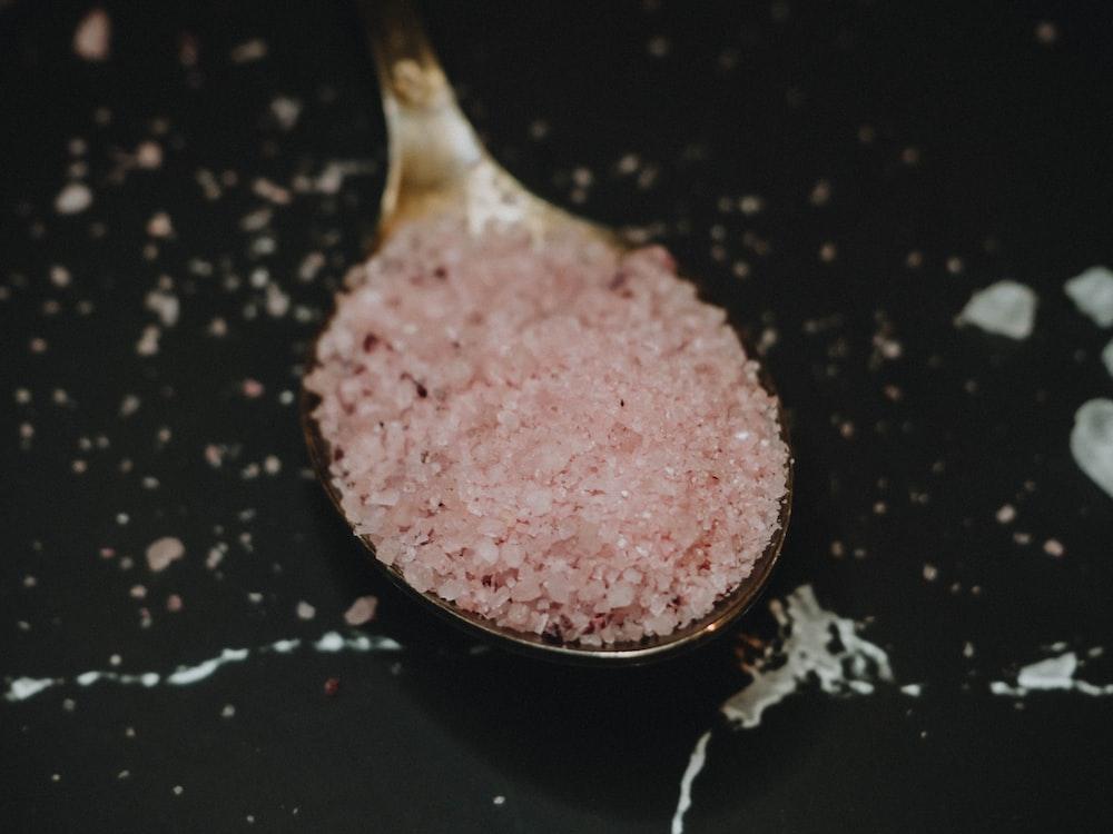 pink powder on black frying pan