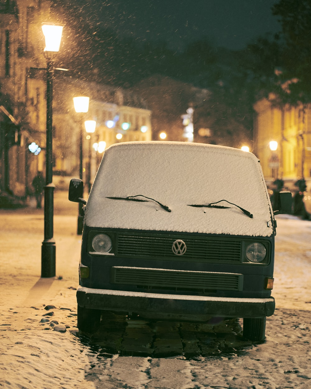 blue volkswagen van on road during night time